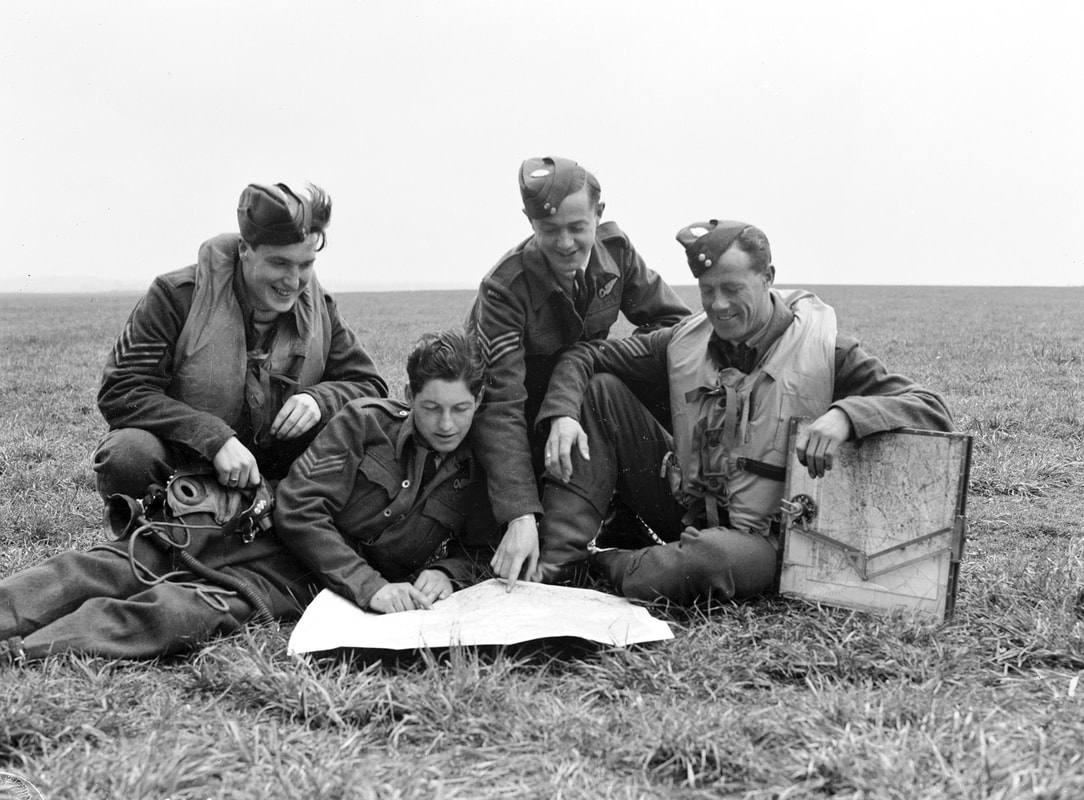 404 Sqn navigators with navigator's table and map
