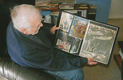 Bill Wheeler showing some of the editorial art he created