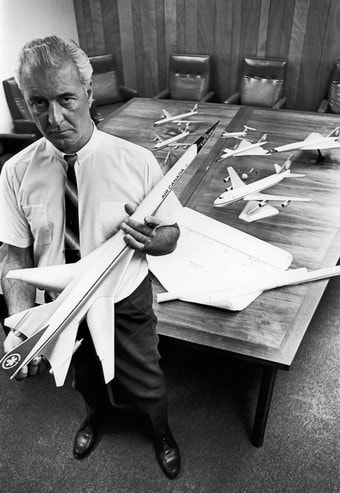 J.E. (John) Hogg of Air Canada holds a Boeing B-2707 model, with other subsonic turbine fleet types and SSTs of the period seen on the table.
